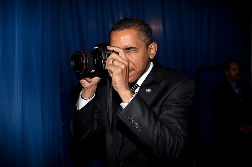 Pres. Obama apparently does not know how to hold a DSLR, but I'm not going to hold it against him. And, as you'll read further in this post, I'm not sure how to attribute this photo. Copyright 2009 by Pete Souza?