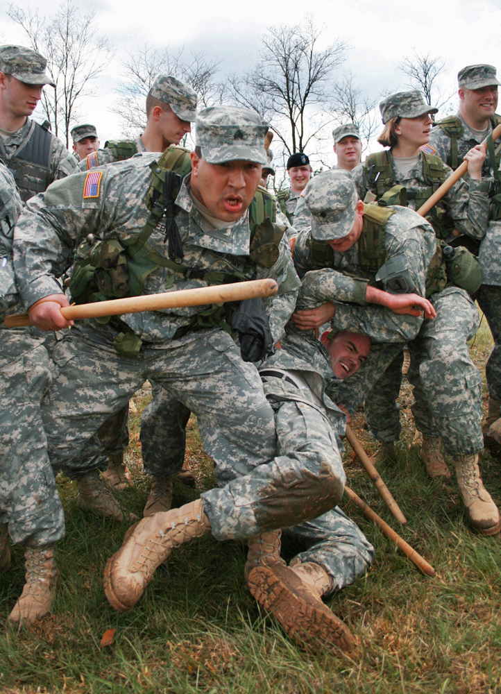 Sgt. Curtis Webb moves forward to reinforce the line formation during the 1140th Military Police Company's riot control training on April 15, 2007. The company, which is a local division of the Missour National Guard, practiced blocks and movement patterns using wooden bats.