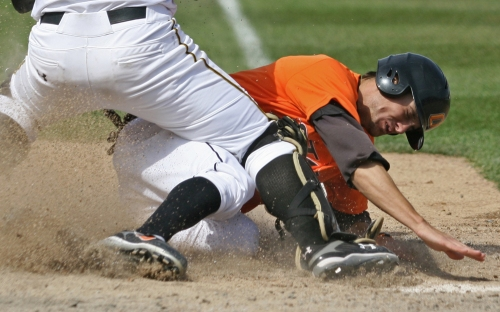 Oklahoma State junior shortstop Jordy Mercer slides home during the series finale against the Tigers on April 6, 2007, in Taylor Stadium. Mercer scored three runs in the game, which the Sooners won 8-6.