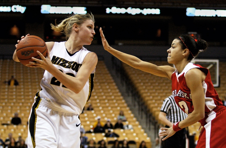 Missouri guard Kassie Drew scans the court to pass the ball away from Nebraska guard Ashly Ford's block during the game's second half on Jan. 20, 2007, at Mizzou Arena. The loss was the Tigers' fifth in conference play.