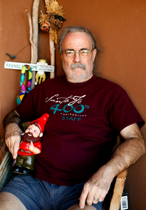 Grant Kalivoda, 67, sits for a portrait in his Santa Fe front porch with Gnorm the Gnome on Tuesday, June 25, 2013.
