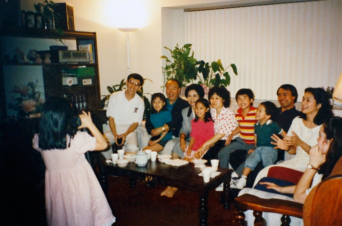 A picture of Chris taking a picture of extended family at Uncle Emmo's Sugar Land house in 1994. Friday, May 2, 2014.
